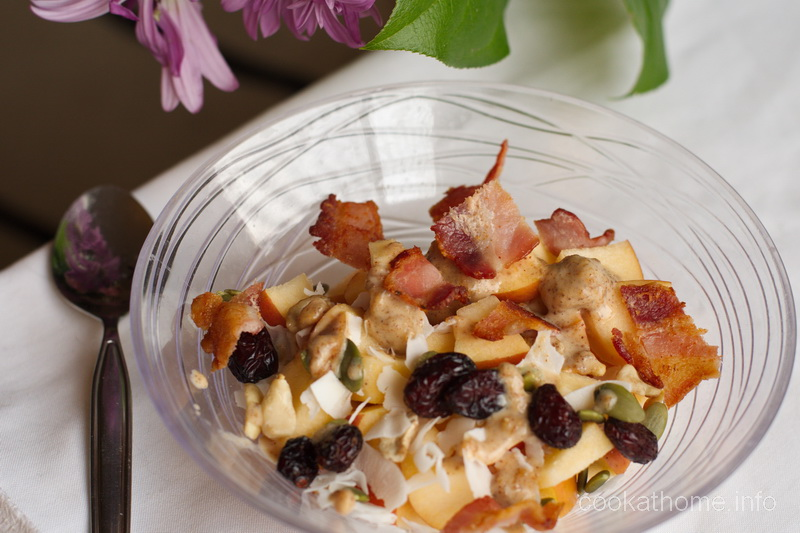 My strange but surprisingly yummy apple bacon breakfast - apple, trail mix, sunflower seed butter and ... bacon.  Because bacon makes everything better! #bacon