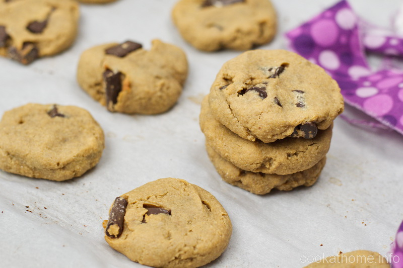 This gluten and dairy free chickpea peanut butter cookie recipe is a completely different texture to most chocolate chip cookies - but oh so yummy! #chickpea