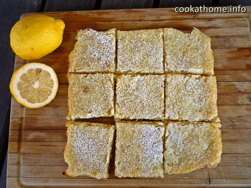 A sweet but tangy, gluten and dairy-free lemon coconut slice with flavor you can see - a real family favorite! #slice