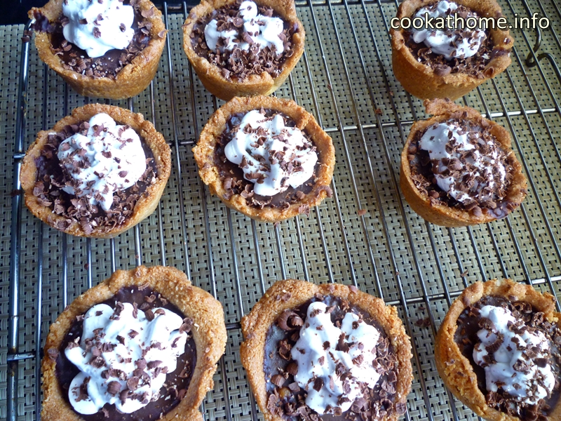 Paleo chocolate cream pies, a decadent dessert with no refined sugar, dairy or gluten! Sure to please even the pickiest critic! ##paleo