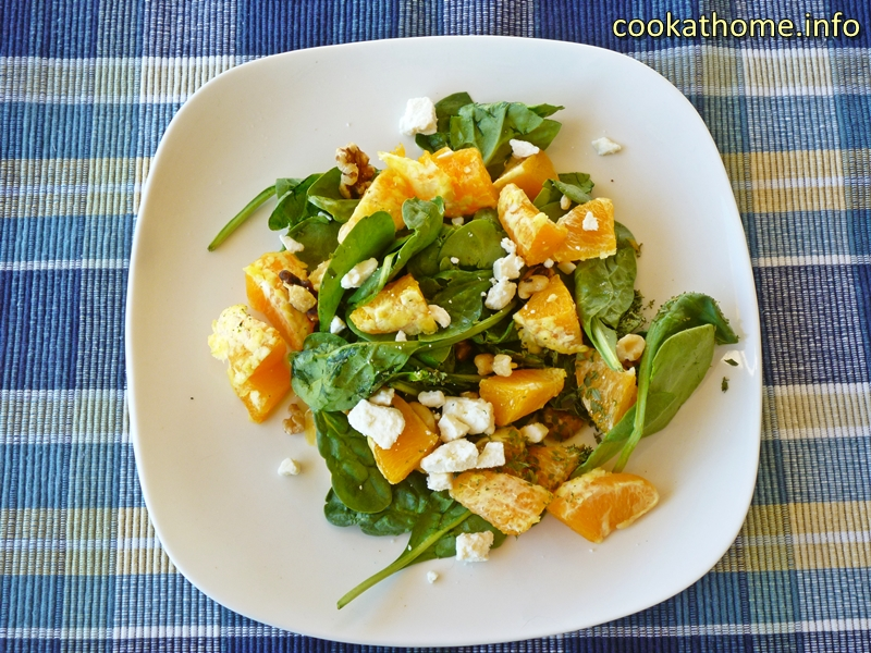 A refreshing spinach orange salad with the contrasting flavors of spinach and orange with nuts for added crunch #salad