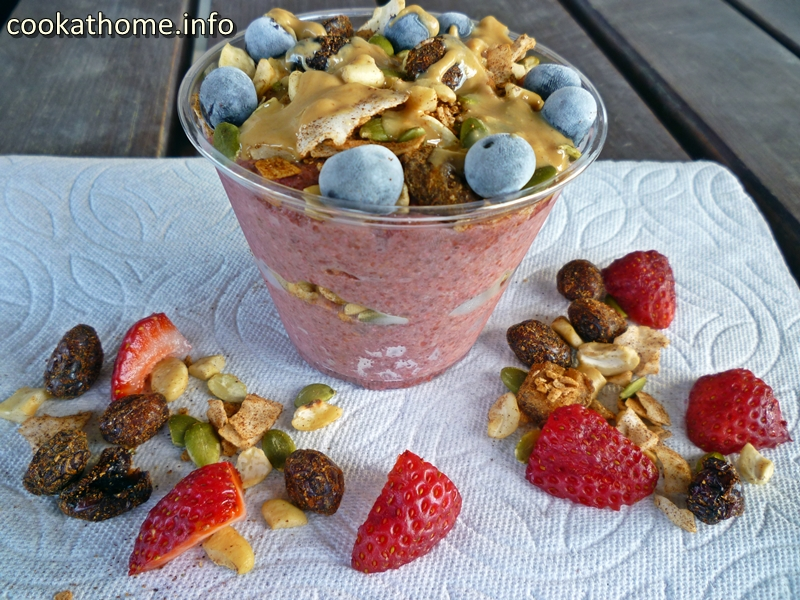 A refreshing breakfast, this strawberry chia pudding, topped with trail mix and nut butter, will keep you full for ages! #chiapudding